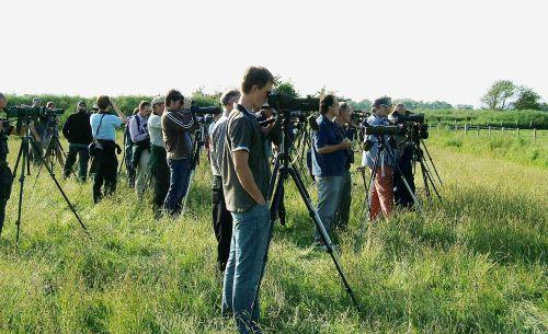 Twitchers in action at Caerlaverock. https://upload.wikimedia.org/wikipedia/commons/d/da/Birders_at_Caerlaverock.jpg